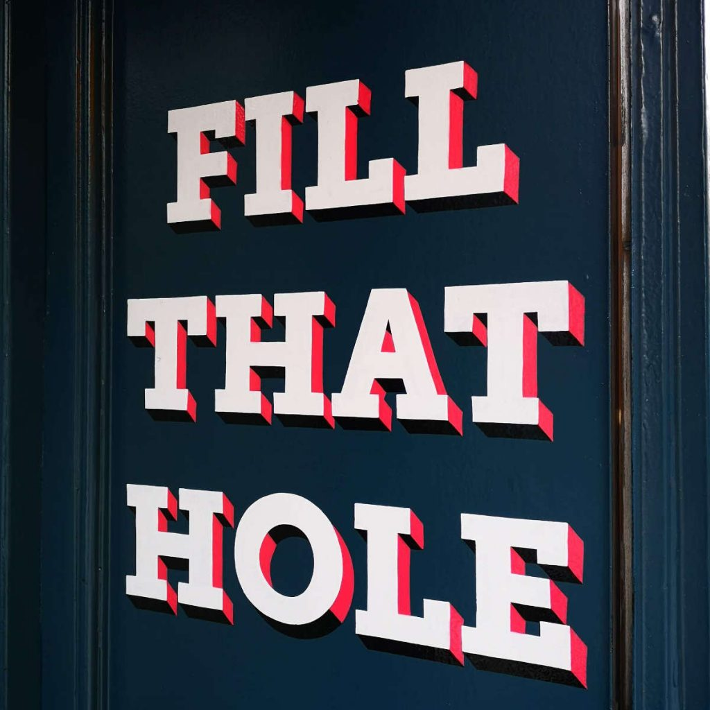 'Fill that Hole' painted on the wall of Bross Bagels, Edinburgh