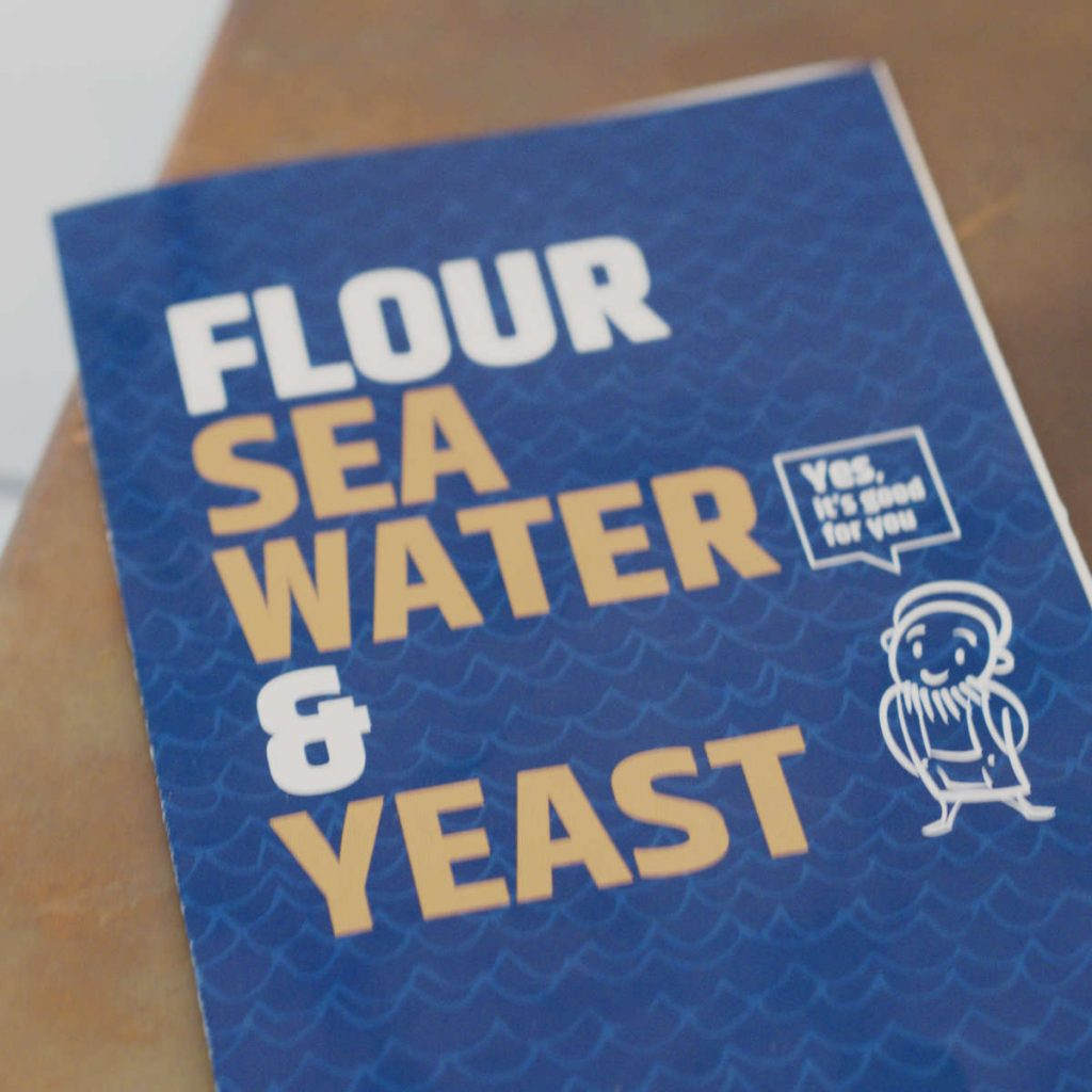 Cover of the menu at Dough Edinburgh which says flour, sea water and yeast
