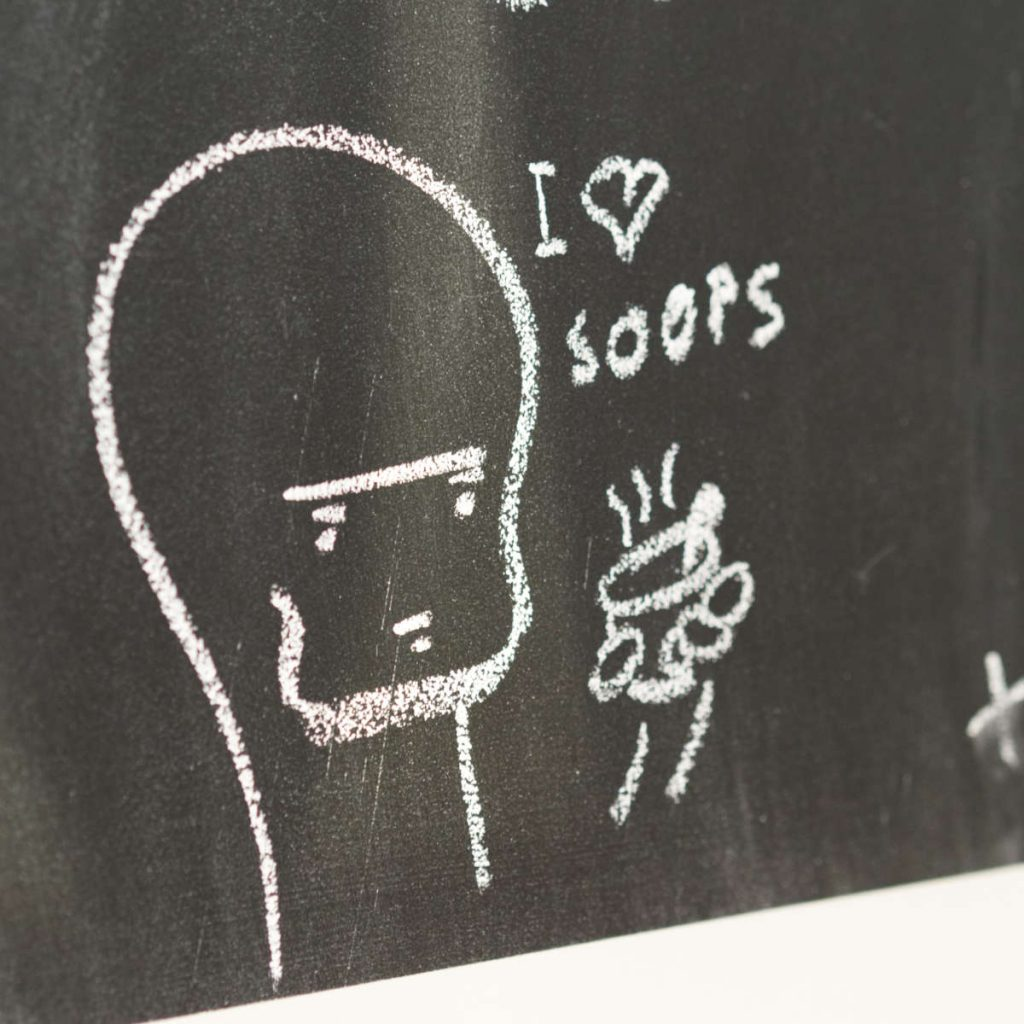 A cartoon doodle written in chalk at Union of Genius, Edinburgh