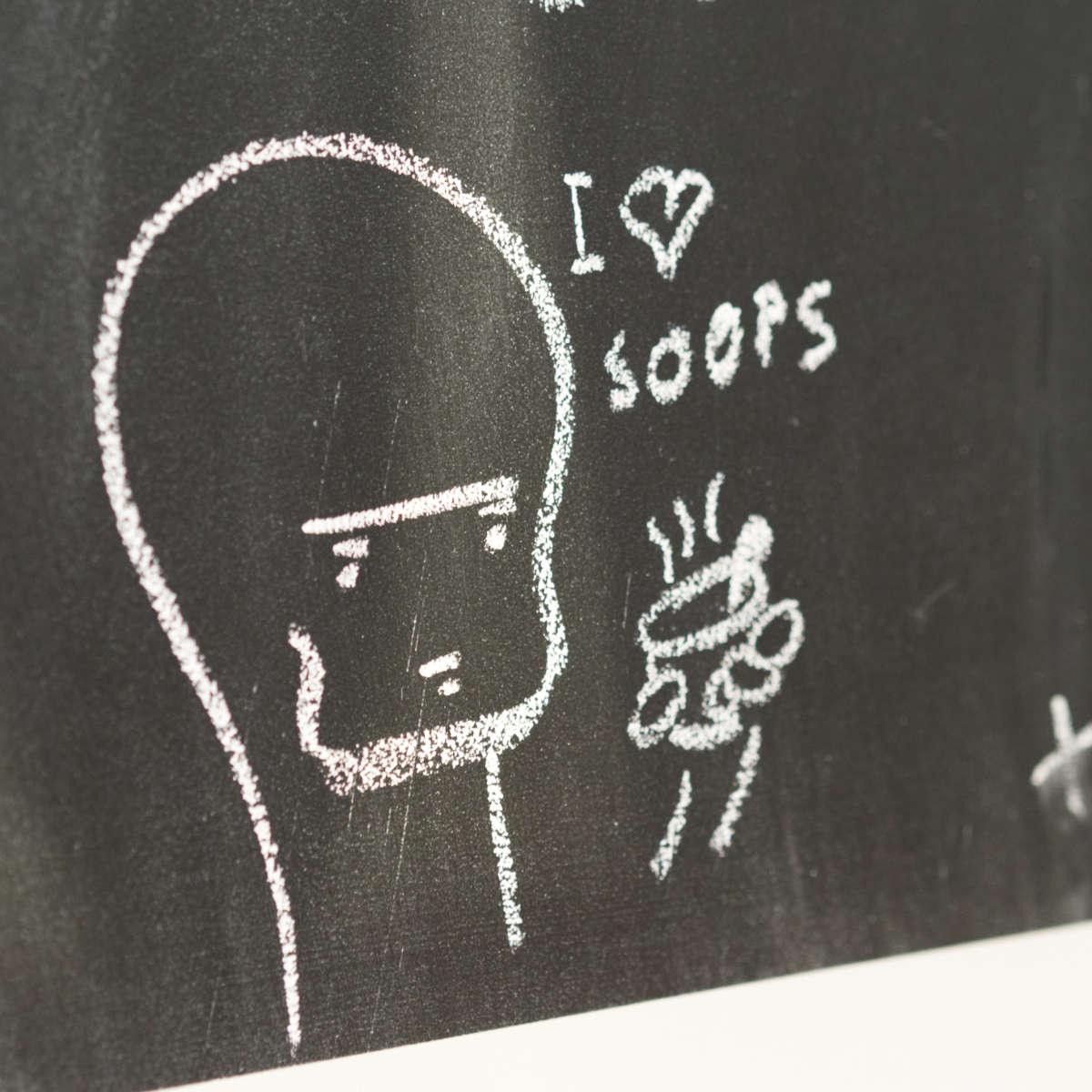 A cartoon doodle written in chalk at Union of Genius, Edinburgh