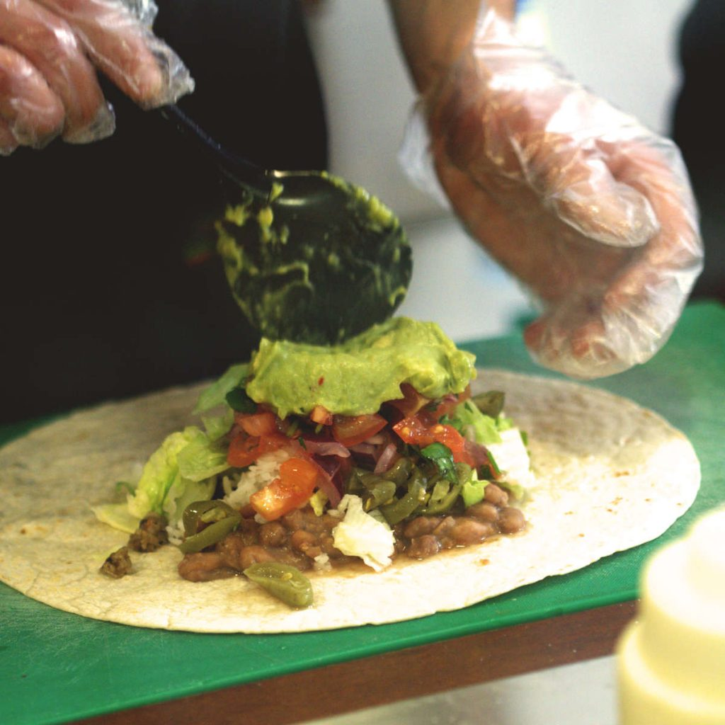 A burrito being made on the production line at Taco Mazama, Edinburgh