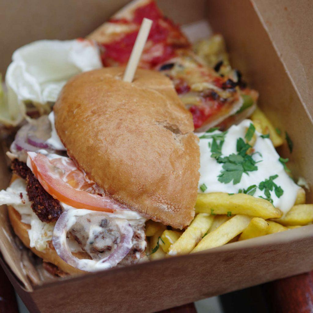 Vegan burger, chips and pizza by Viva La Vegan
